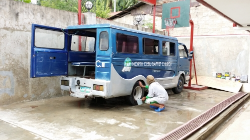 Cleaning the Church Jeep
